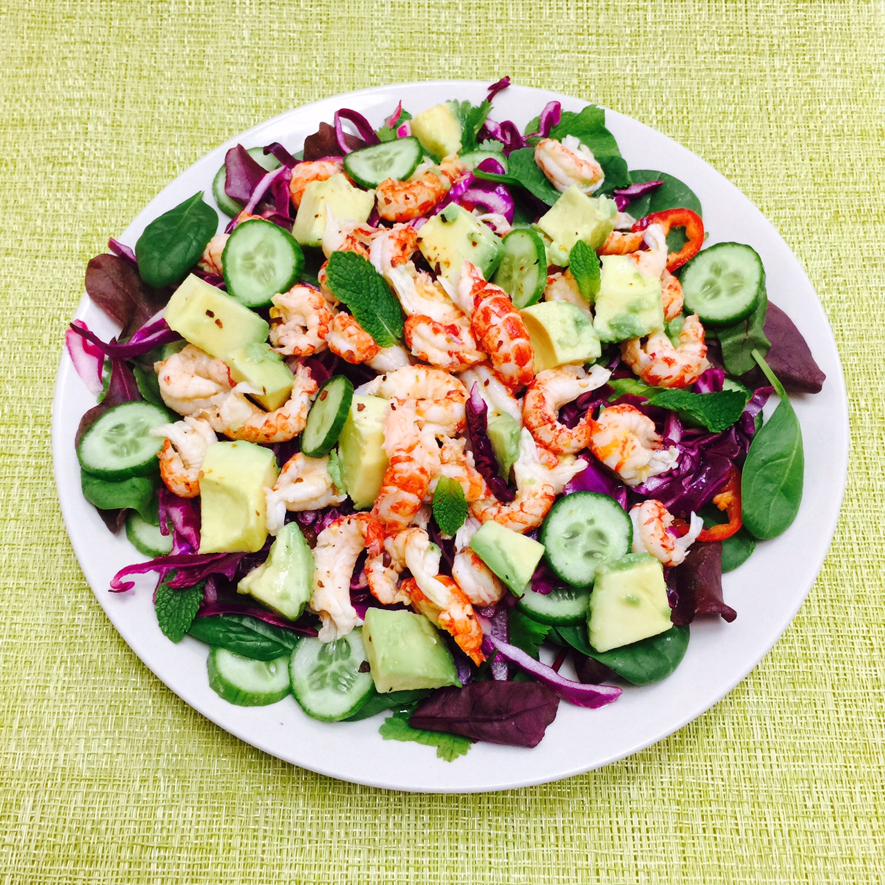 Crayfish salad with avocado, red cabbage and cucumber