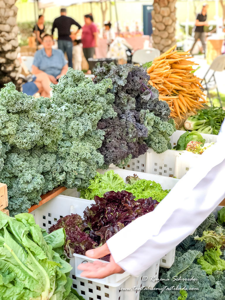 Kale and carrots on a farmers market table
