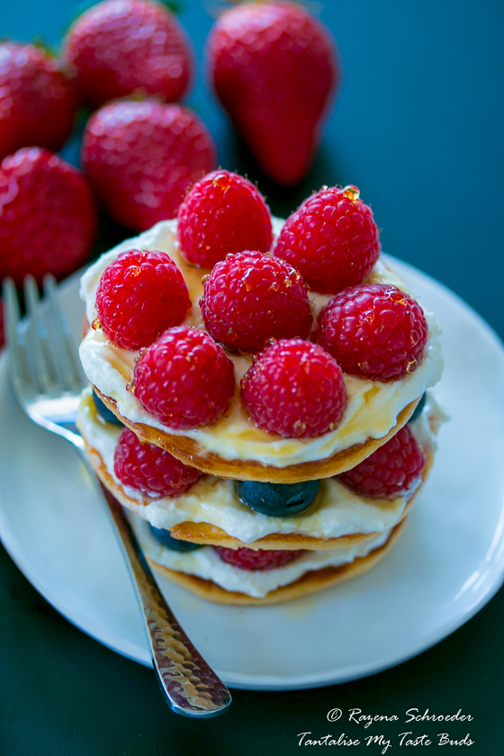Almond and Coconut breakfast pancakes with mascarpone cream and raspberries
