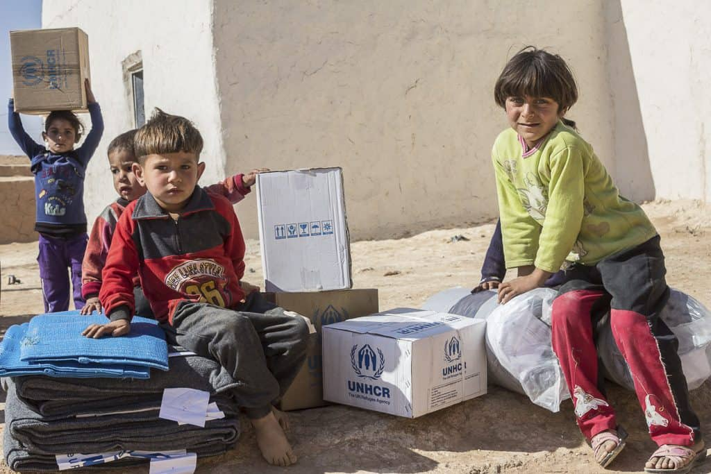 Returning families receive their winter and core relief items that UNHCR is distributing in east Aleppo