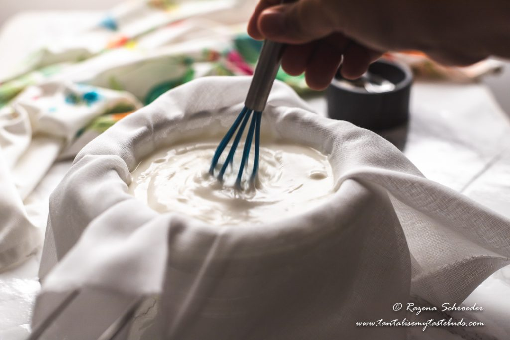 Mixing yogurt with salt for labneh