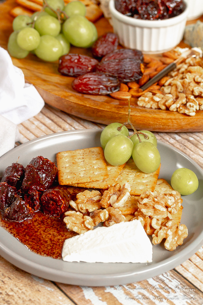 Cape Malay Sour figs konfyt snack with crackers, nuts and cheese